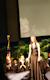Roberta Rehner receiving ovation from graduates